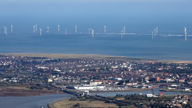 FILE PHOTO: Scroby Sands offshore wind farm can be seen off of the coast at Great Yarmouth