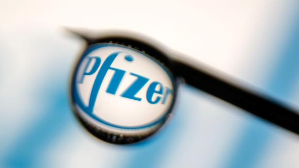 FILE PHOTO: Pfizer logo is reflected in a drop on a syringe needle in this illustration photo