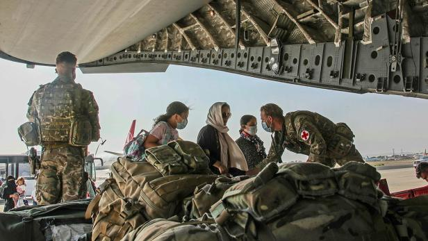 British citizens and dual nationals residing in Afghanistan board a military plane for evacuation from Kabul airport