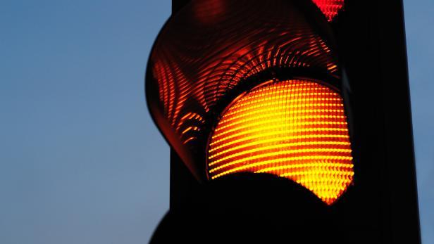 Traffic light against sunset