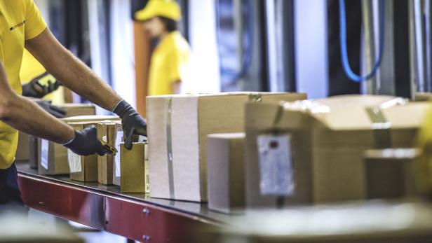 Postal worker handling packages