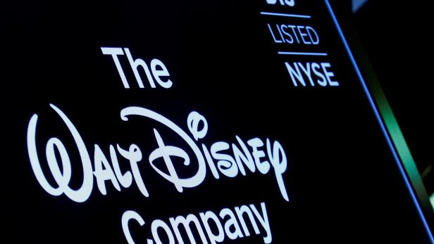FILE PHOTO: FILE PHOTO: A screen shows the trading info for The Walt Disney Company company on the floor of the NYSE in New York