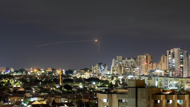 Streaks of light are seen as Israel's Iron Dome anti-missile system intercepts a rocket launched from the Gaza Strip towards Israel, as seen from Ashkelon