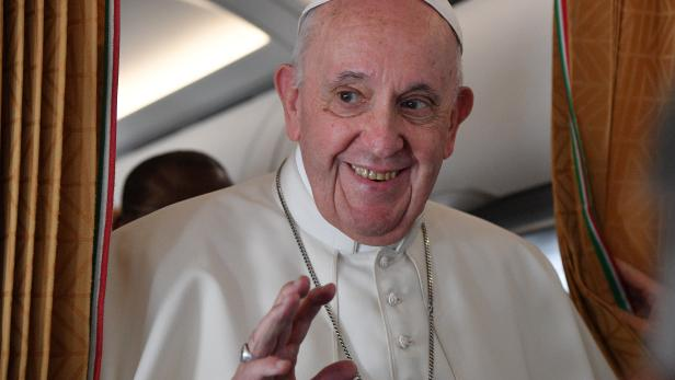 Pope Francis speaks to the media on board an Alitalia aircraft