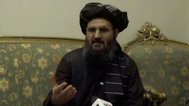 Afghanistan's acting deputy prime minister Baradar speaks during an interview in Kandahar