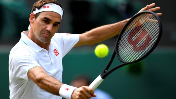 FILE PHOTO: FILE PHOTO: Switzerland's Roger Federer in action during his third round match at Wimbledon