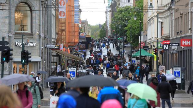 FILE PHOTO: People walk at Karl Johans street in Oslo