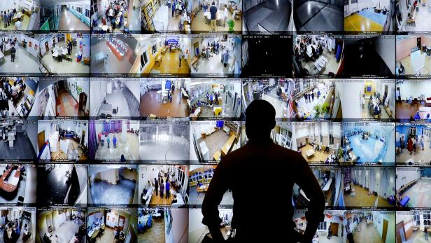 FILE PHOTO: A man looks on a screen showing polling stations, at the headquarters of Russia's Central Election Commission in Moscow