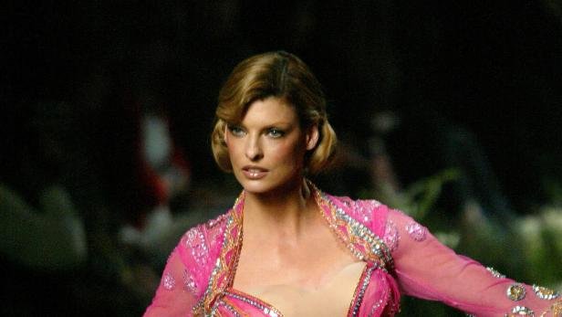 FILE PHOTO: Top model Linda Evangelista presents this creation by British designer John Galliano for French fash..