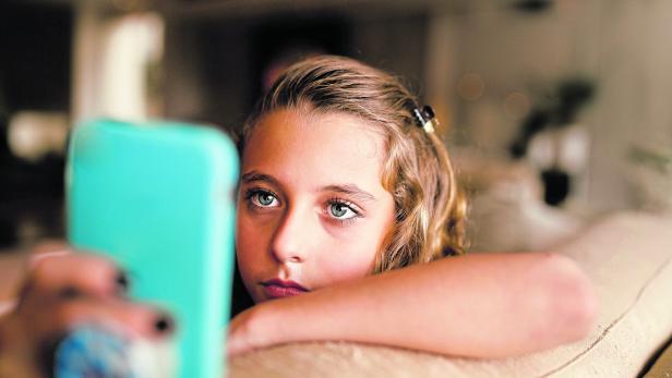 Teenage girl using social media on phone