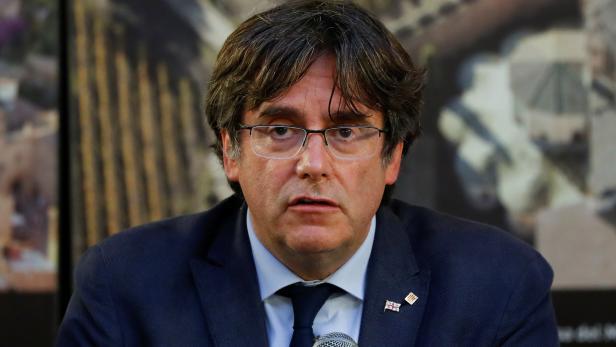 Former Catalan government head Carles Puigdemont visits Alghero