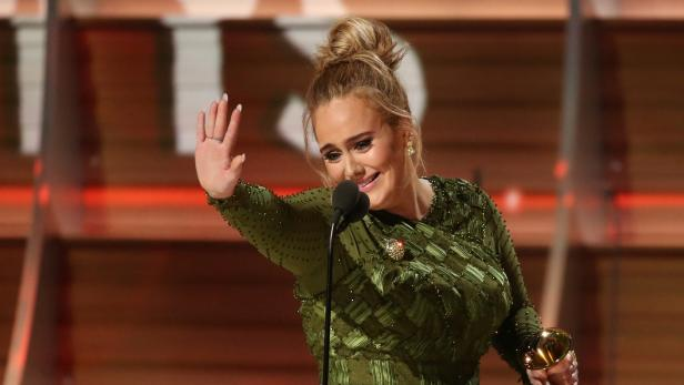 """FILE PHOTO: Adele and co-song writer Kurstin accept the Grammy for Song of the Year for """"Hello"""" at the 59th Annual Grammy Awards in Los Angeles"""