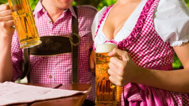 Happy Couple in Beer garden drinking