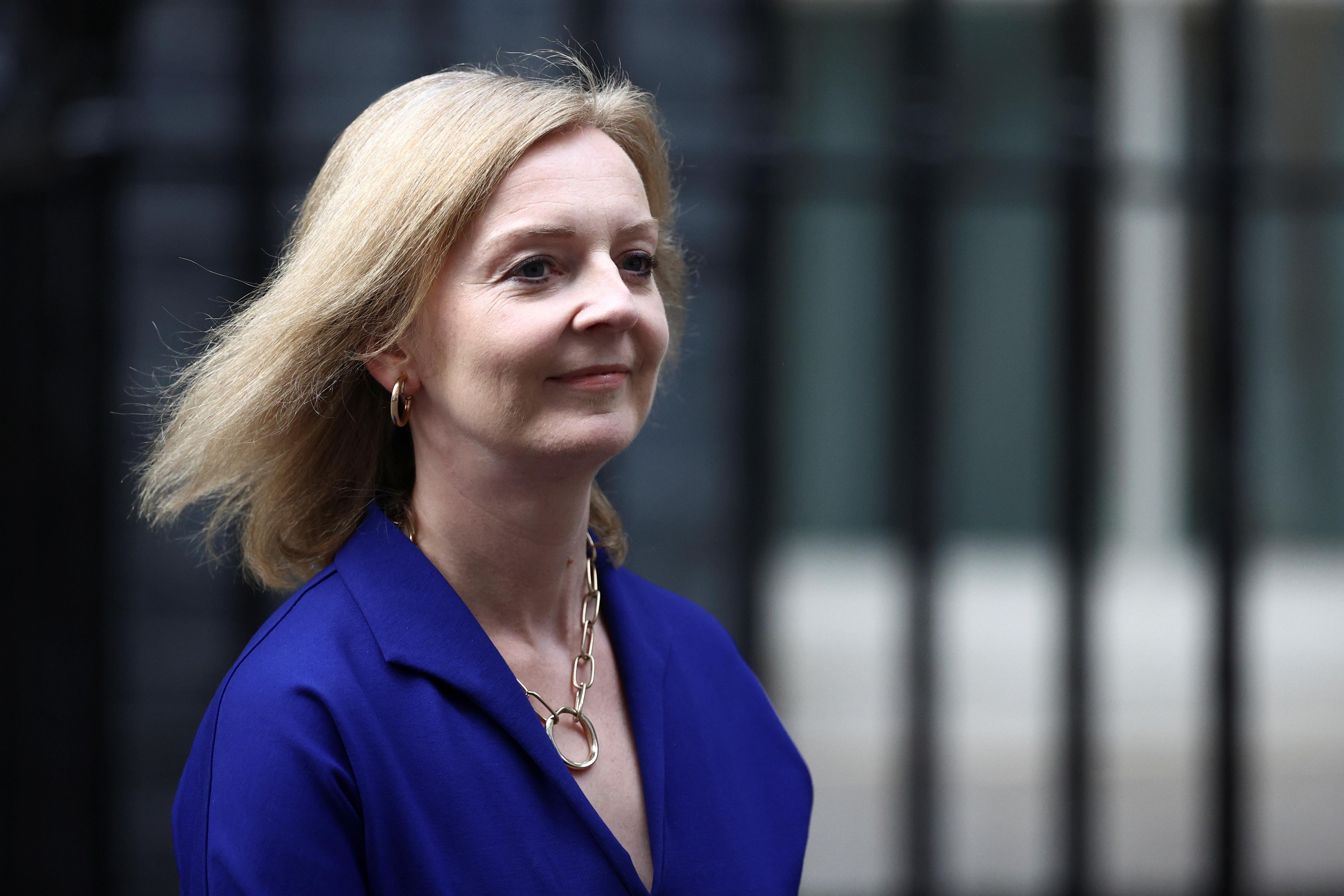 Britain's Foreign Secretary Liz Truss walks outside Downing Street in London